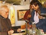 Dr. Manfred Schemel beim Signieren seiner Bücher Foto: Privat Dr. Schemel